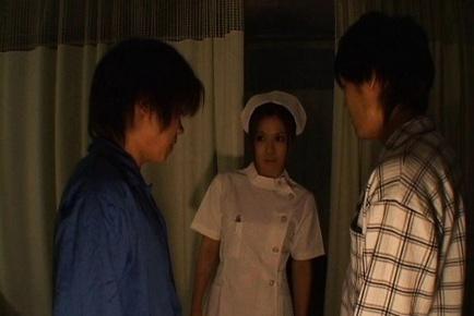 Manaka Kazuki Asian nurse gives a double blowjob