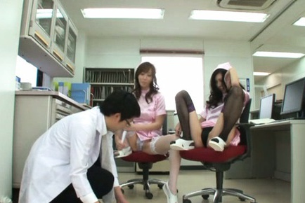 Cute Japanese nurses in sexy stockings seduce their colleague