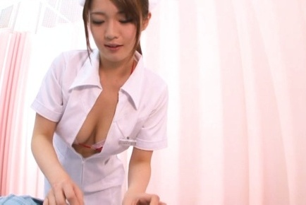 Busty Asian nurse Eri Hosaka performs a masterful titfuck session