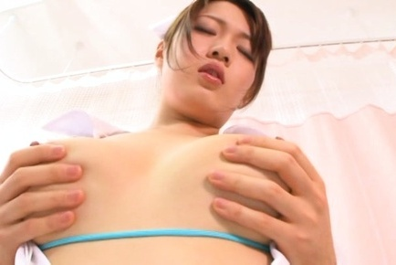 Busty Tokyo nurse Eri Hosaka shows off her precious bubble for a cam